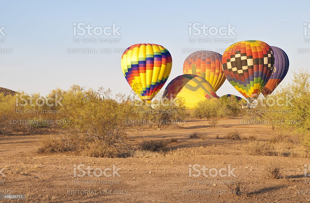 Hot Air Balloons Preparing for Take Off in the Desert stock photo