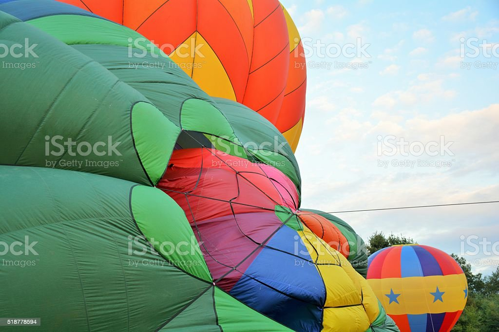 Hot Air Balloons Preparing to Inflate stock photo