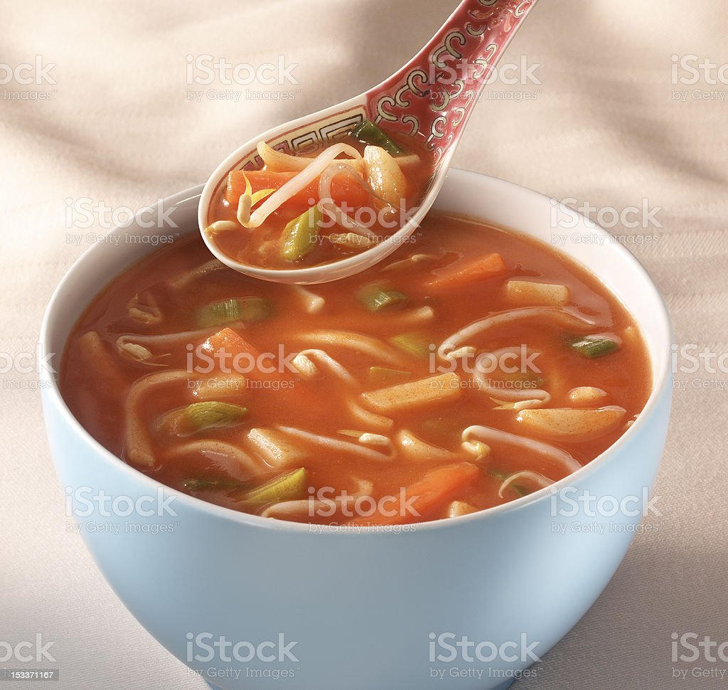 Hot and sour chinese soup in a white bowl royalty-free stock photo