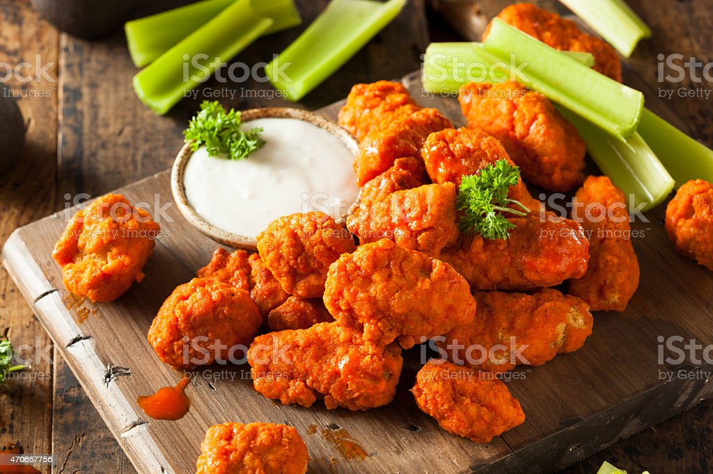 Hot and spicy boneless buffalo chicken wings platter stock photo