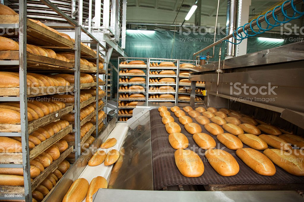 Hot baked breads on a line stock photo
