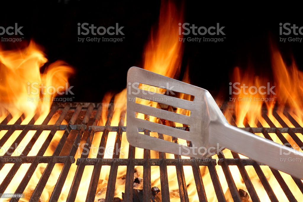 Hot BBQ Grill Tools In The Flame stock photo