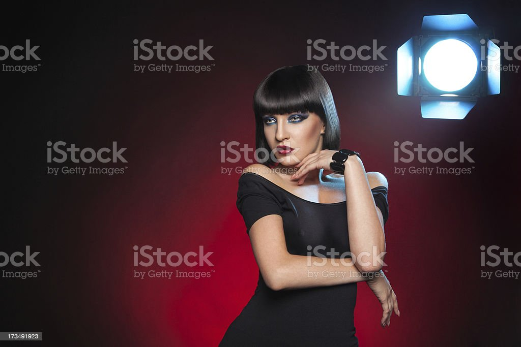 Hot brunette with flash in the shot royalty-free stock photo