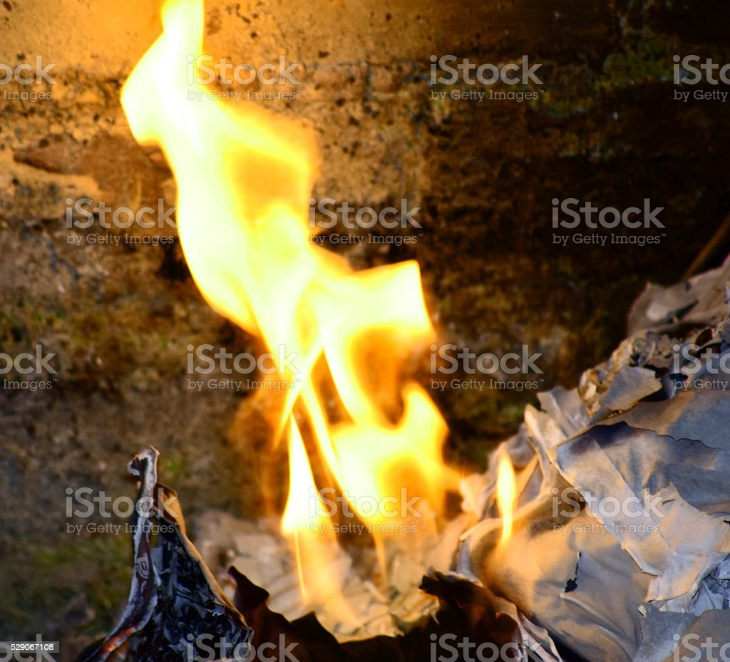 hot burning paper flaming fire stock photo