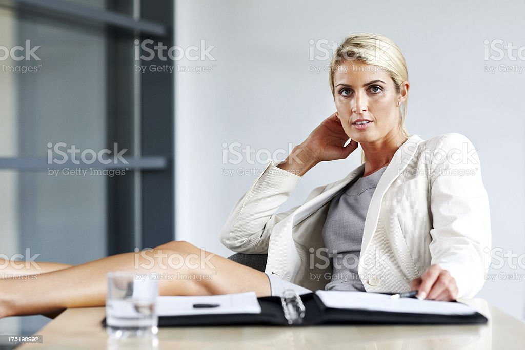 Hot Business Woman Sitting In The Office stock photo 175198992