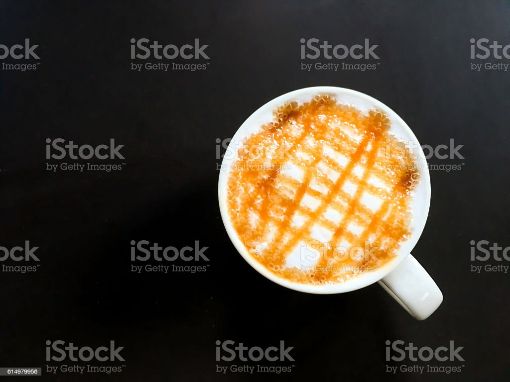Hot Caramel Coffee top view with black copy space. stock photo