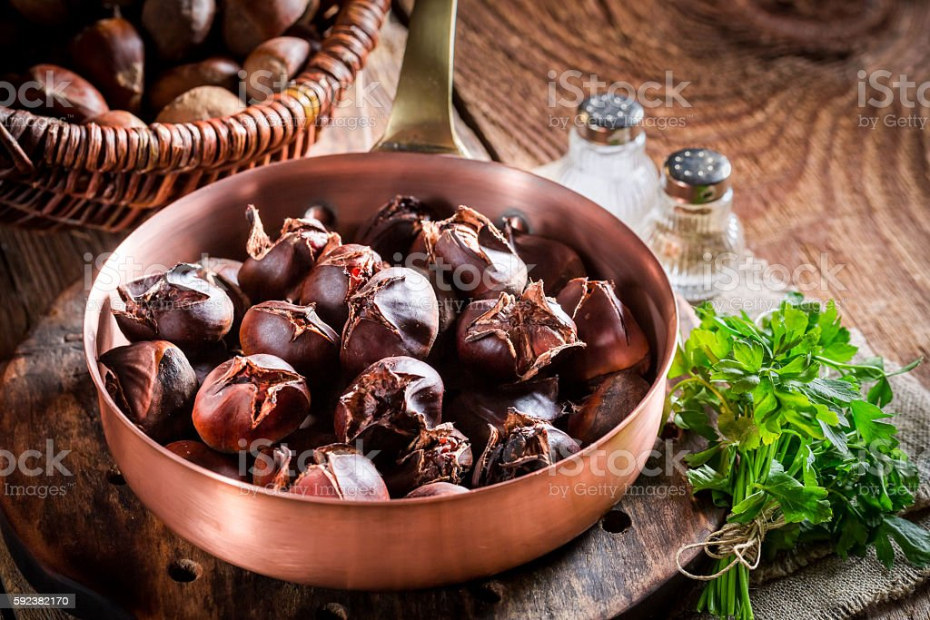 Hot chestnuts with garlic sauce stock photo