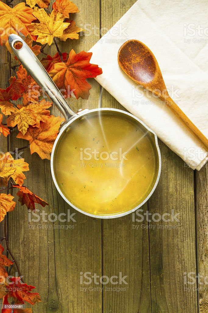Hot Chicken Noodle Soup With Fall Leaves stock photo
