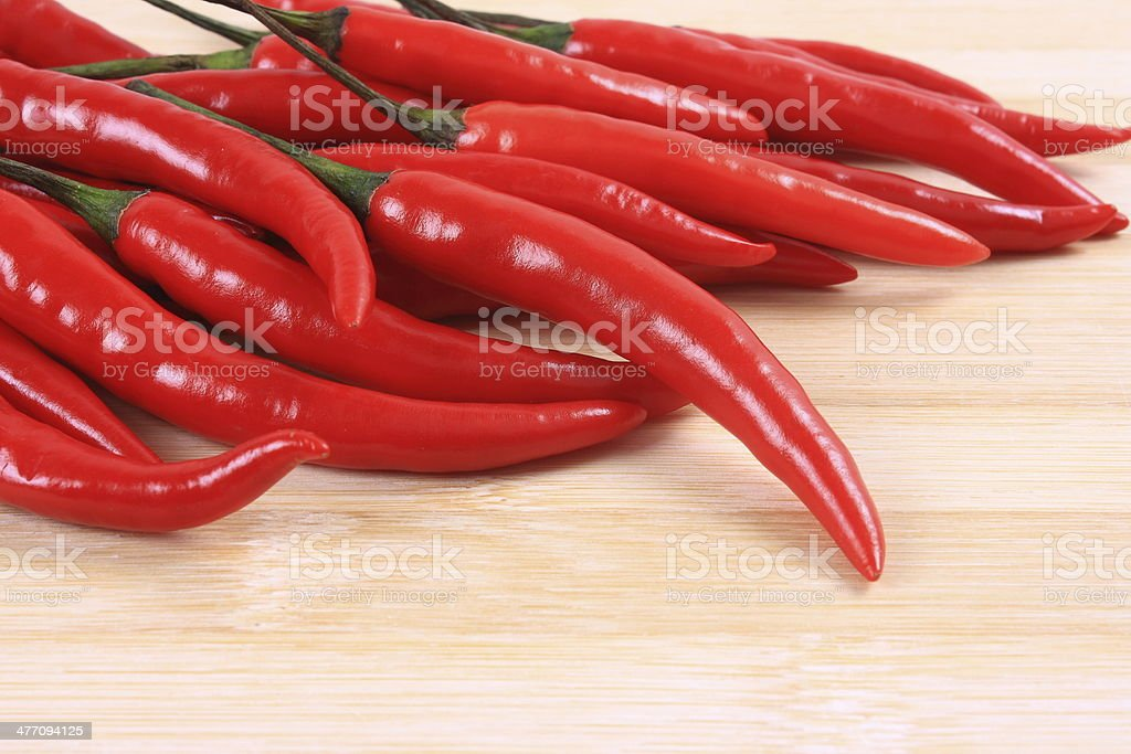 Hot chili pepper on the chopping block stock photo