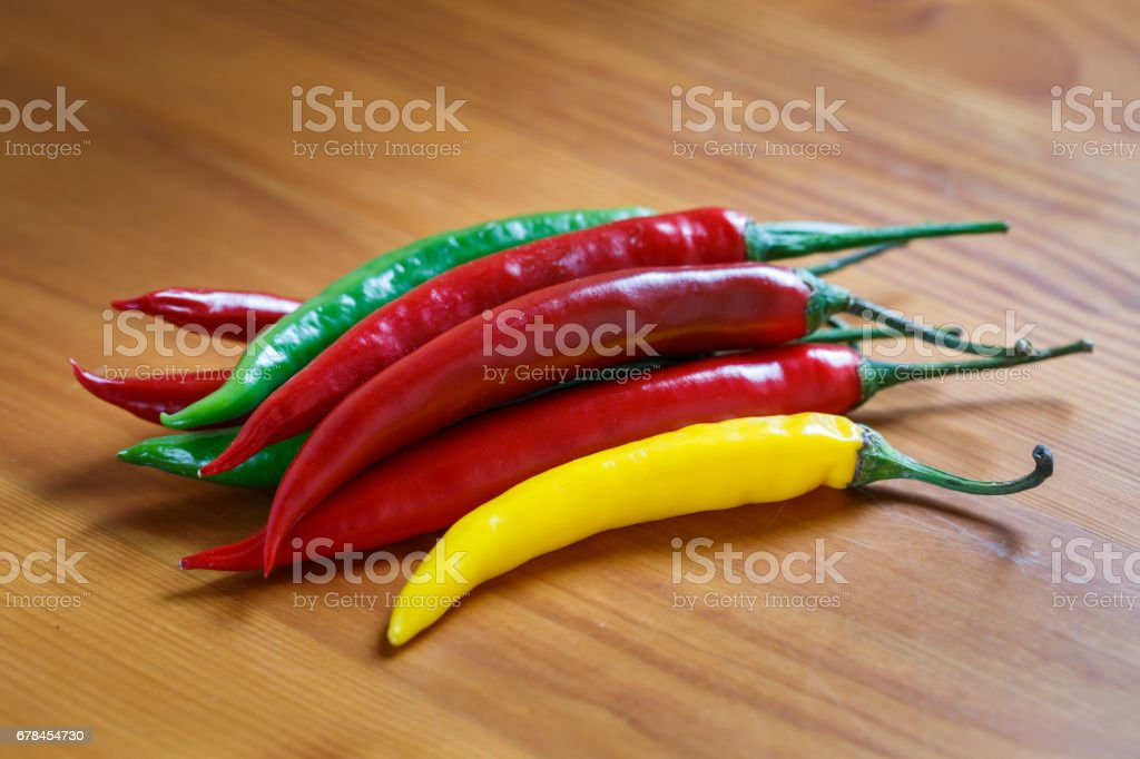 Hot chili peppers. Chilli pepper on the wooden background. stock photo
