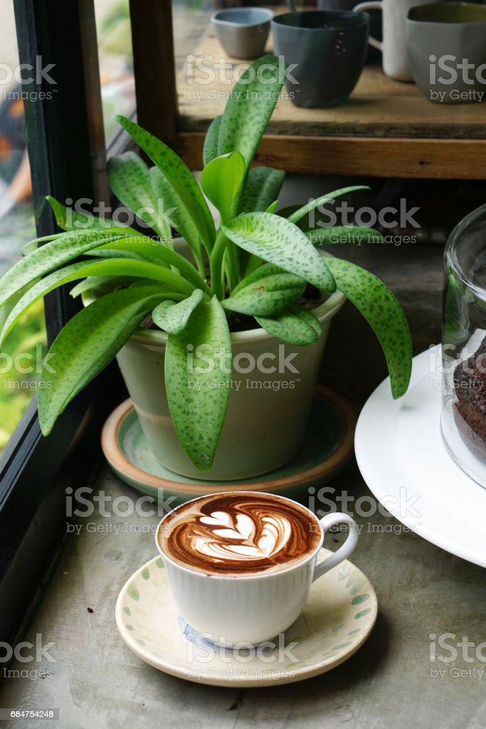 Hot chocolate - A cup of dark chocolate with beautiful latte art on cement background. stock photo