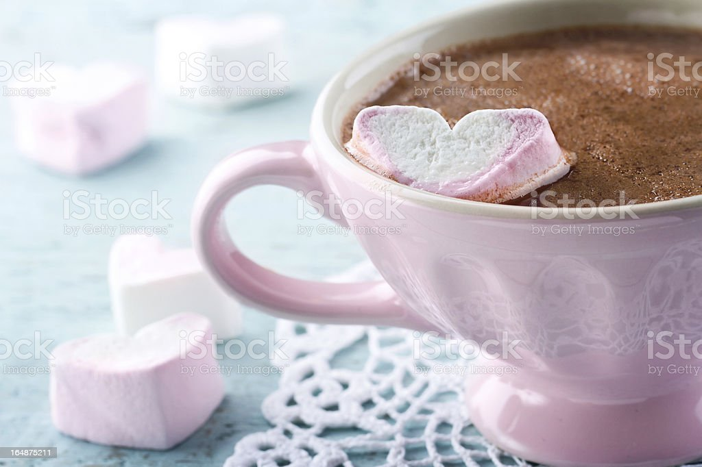 Hot chocolate and a heart shaped marsmallow royalty-free stock photo