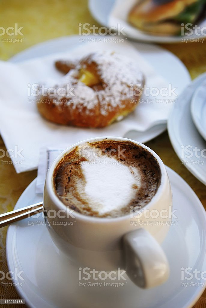 hot chocolate and croissant in rome stock photo