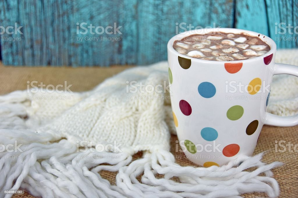 hot chocolate drink with knit scarf stock photo