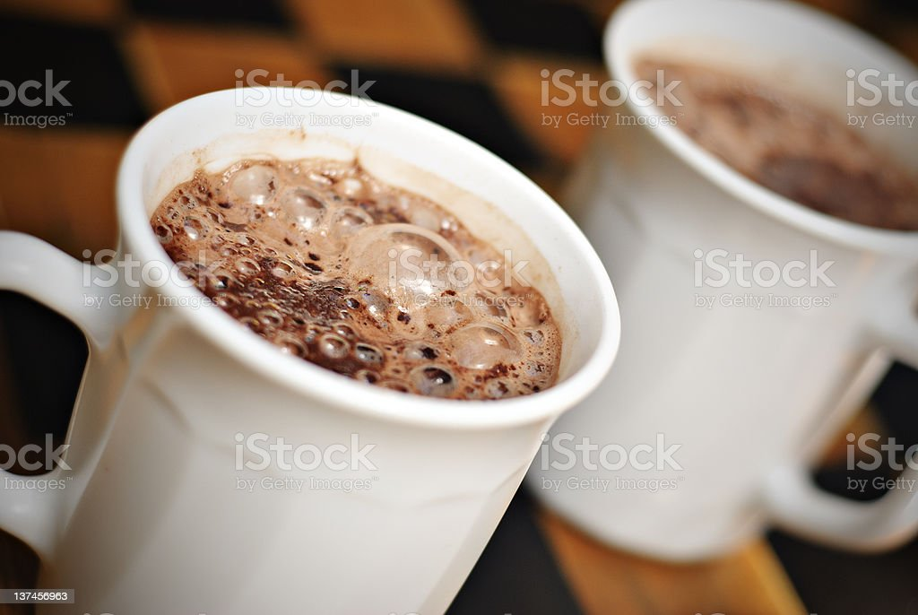 Hot Chocolate on White Mugs royalty-free stock photo