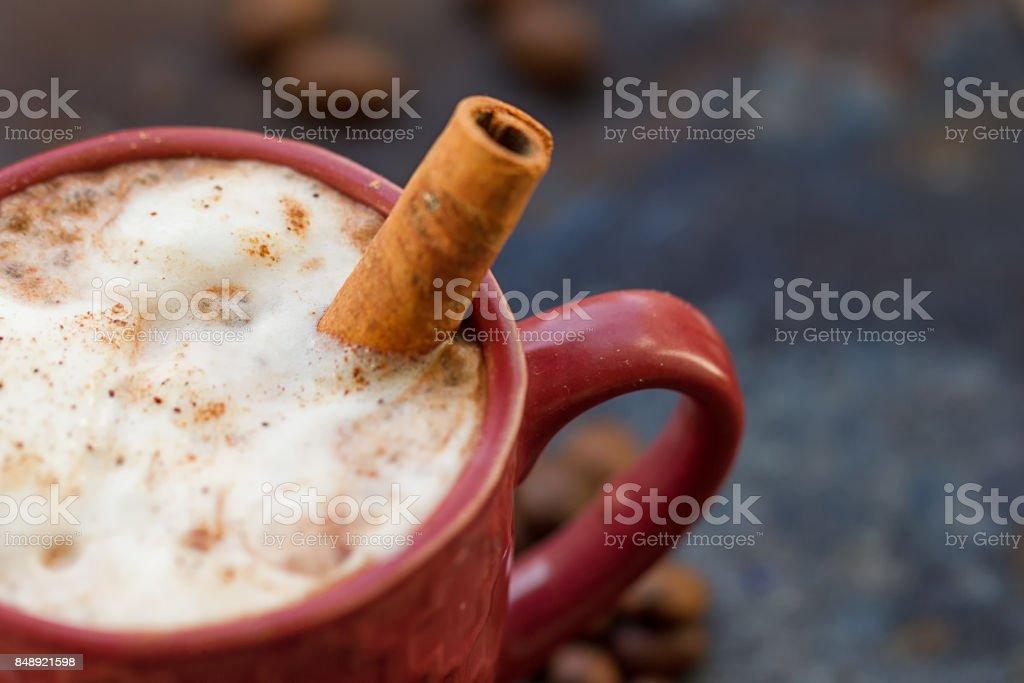 Hot chocolate with cinnamon stick stock photo