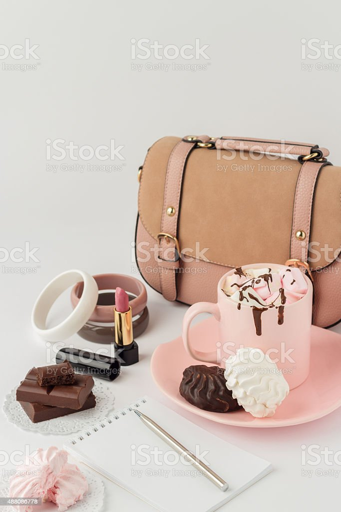 Hot chocolate with marshmallows and women's  fashion accessories stock photo
