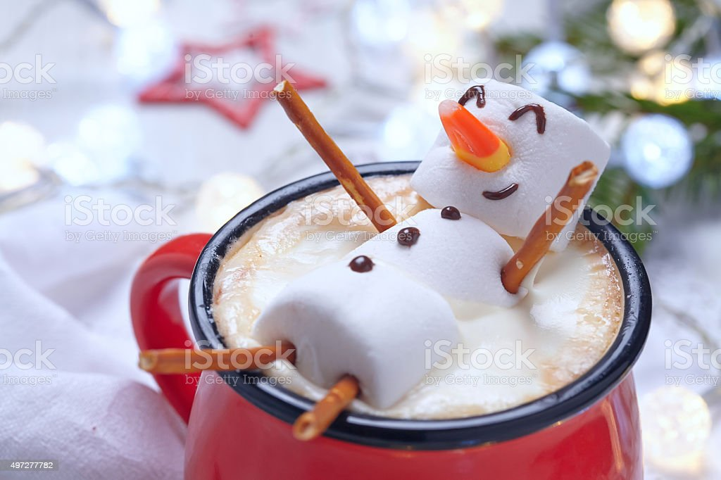 Hot chocolate with melted snowman stock photo