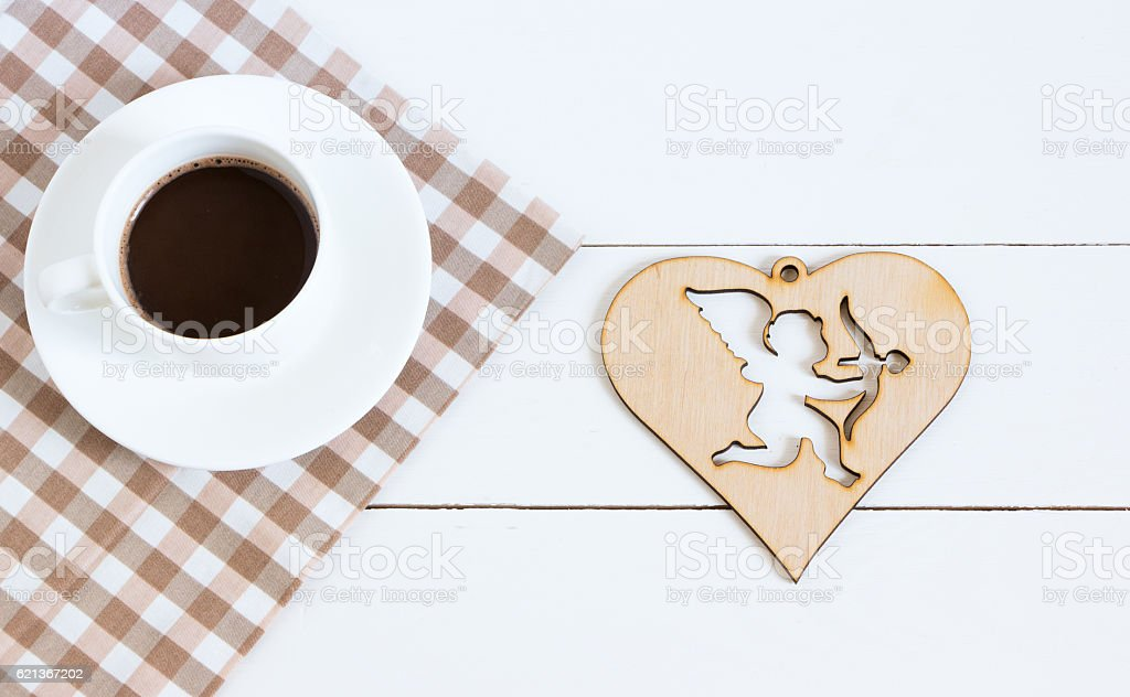 Hot chocolate with napkin and cupid figure on a white stock photo