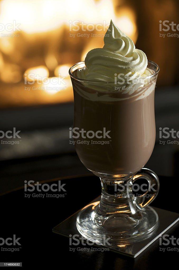 Hot Chocolate with Whipped Cream by a Fireplace royalty-free stock photo