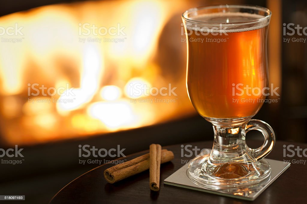 Hot Cider by the Fire stock photo