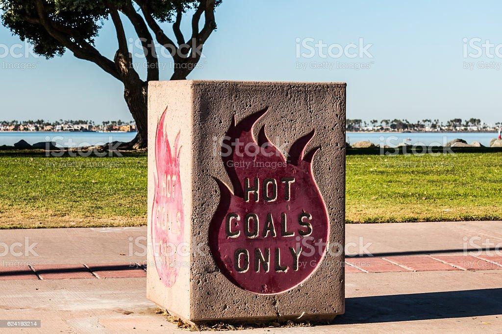 Hot Coals Disposal Bin at a Bayside Park stock photo