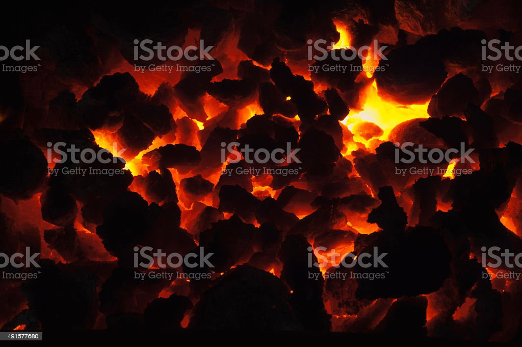 Hot coals in a domestic fire stock photo