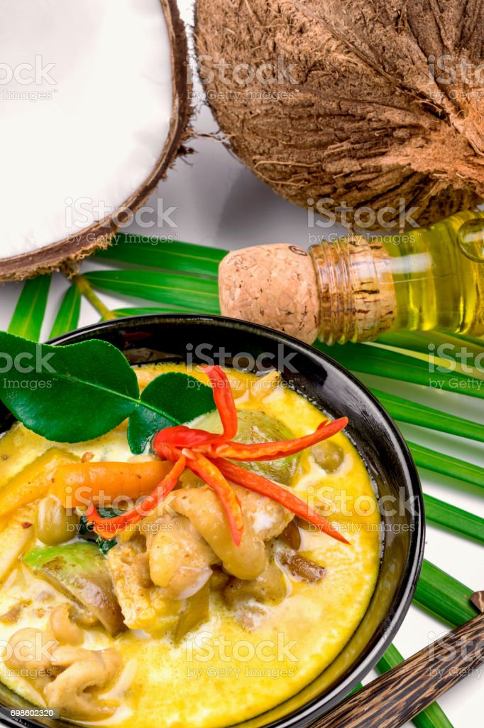 Hot coconut chicken soup with chili and curry In a bowl stock photo