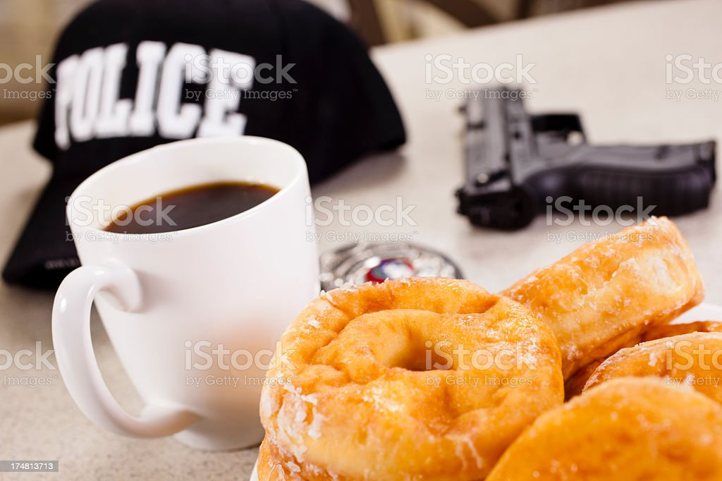 Hot Coffee and donut break for policeman royalty-free stock photo