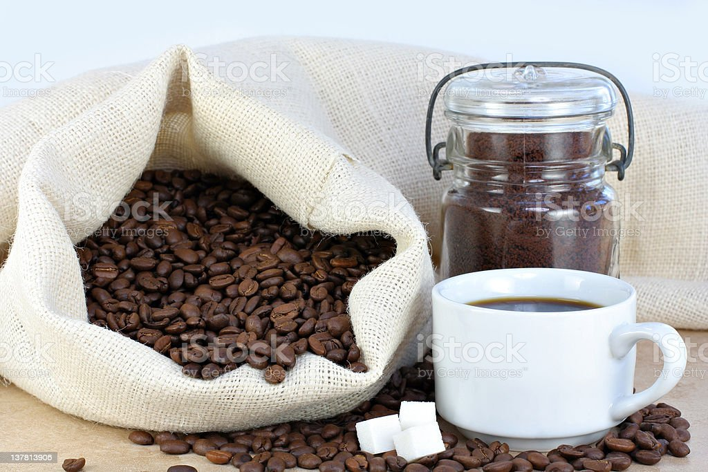 Hot coffee, beans and sugar cubes. royalty-free stock photo