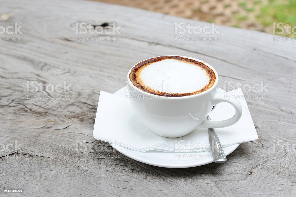 hot coffee cappuccino in cup on table (style still life) stock photo
