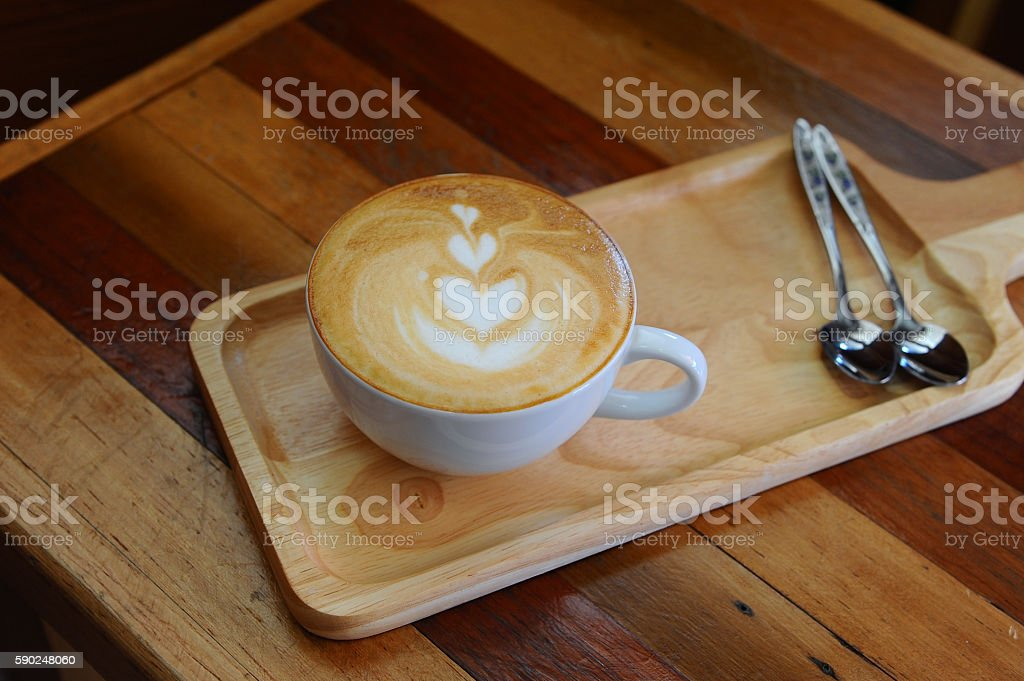 hot coffee cappuccino in cup on wooden table stock photo