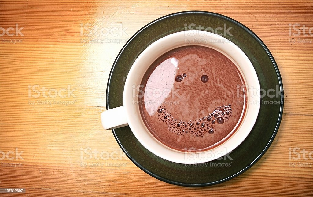 Hot Coffee Drink With Smile Face in Bubbles royalty-free stock photo
