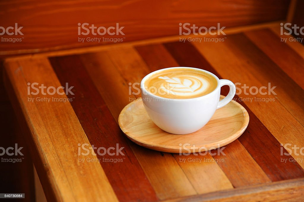 hot coffee in cup on wooden table (Style Still Life) stock photo