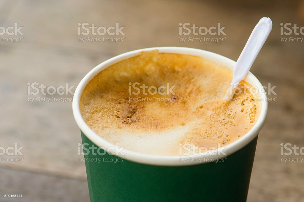 hot coffee in paper cup on wood texture stock photo