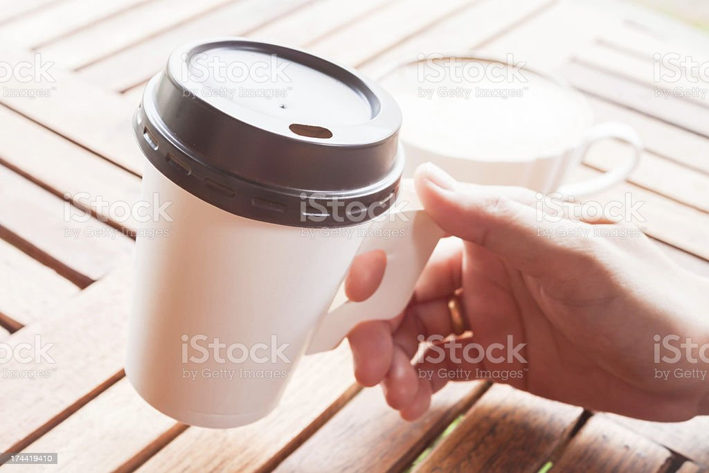 Hot coffee in paper cup serving at the shop stock photo