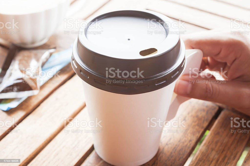 Hot coffee in paper cup serving on wood table stock photo