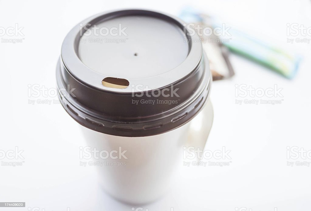 Hot coffee in paper cup with sugar packs stock photo