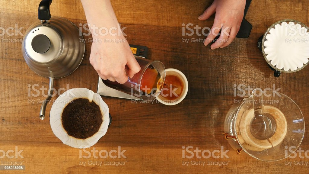 Hot coffee is splashing in cup stock photo