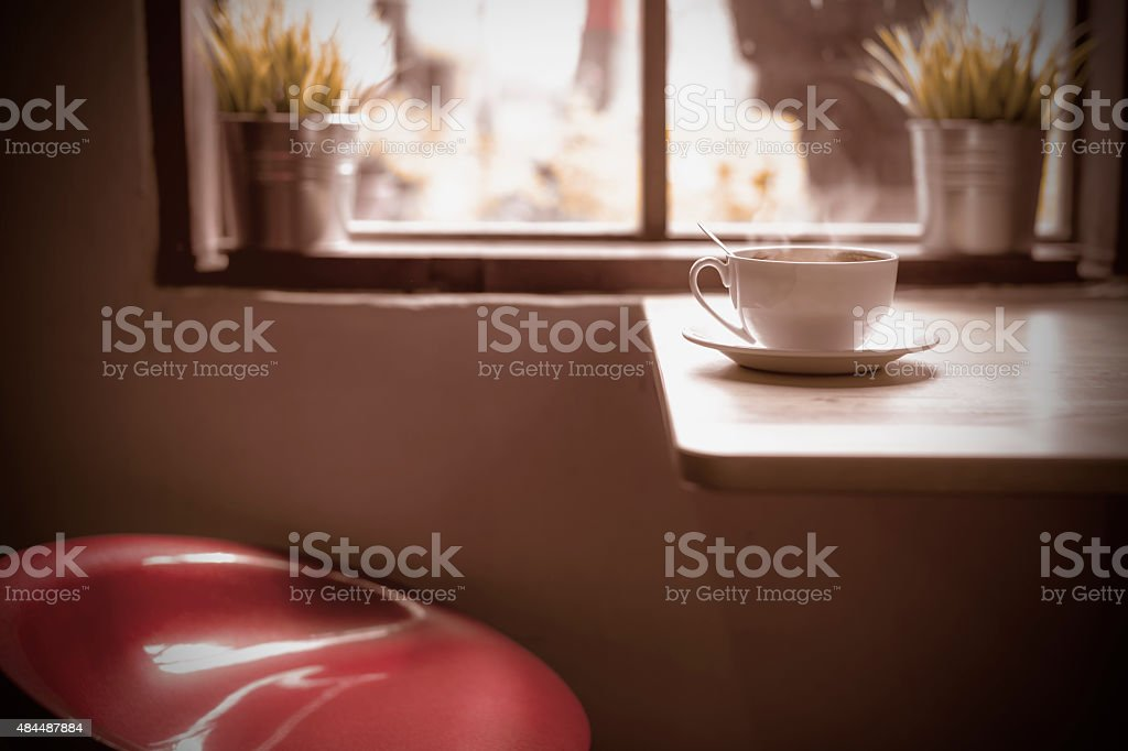 Hot coffee on table and red chair. royalty-free stock photo