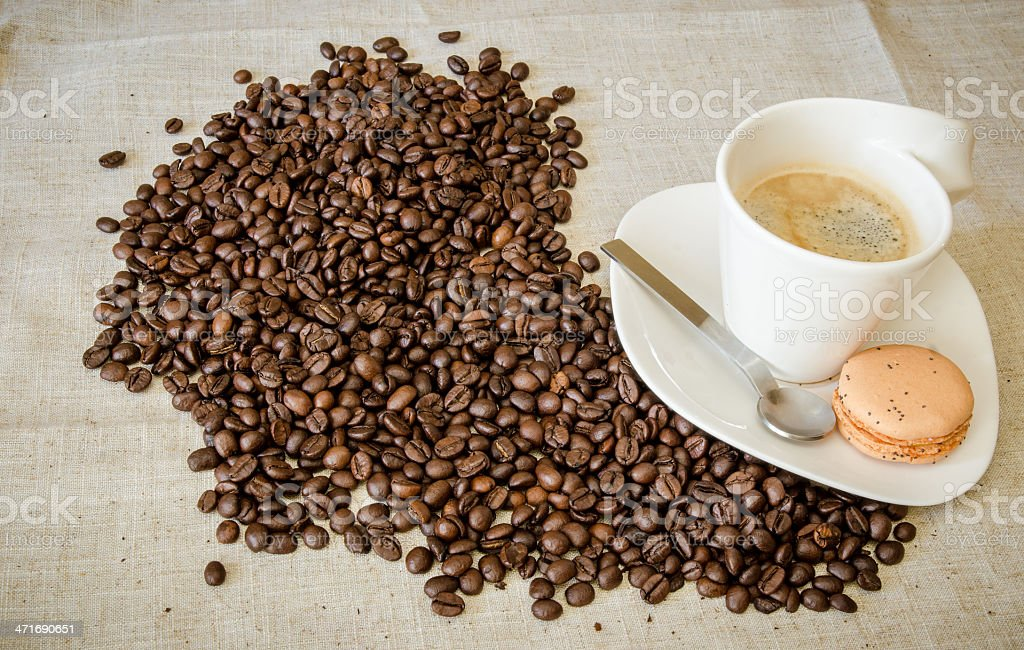 Hot coffee with beans royalty-free stock photo