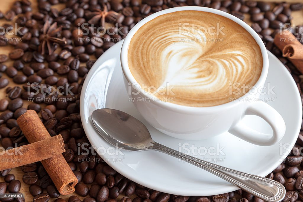 hot coffee with coffee beans and herbs stock photo