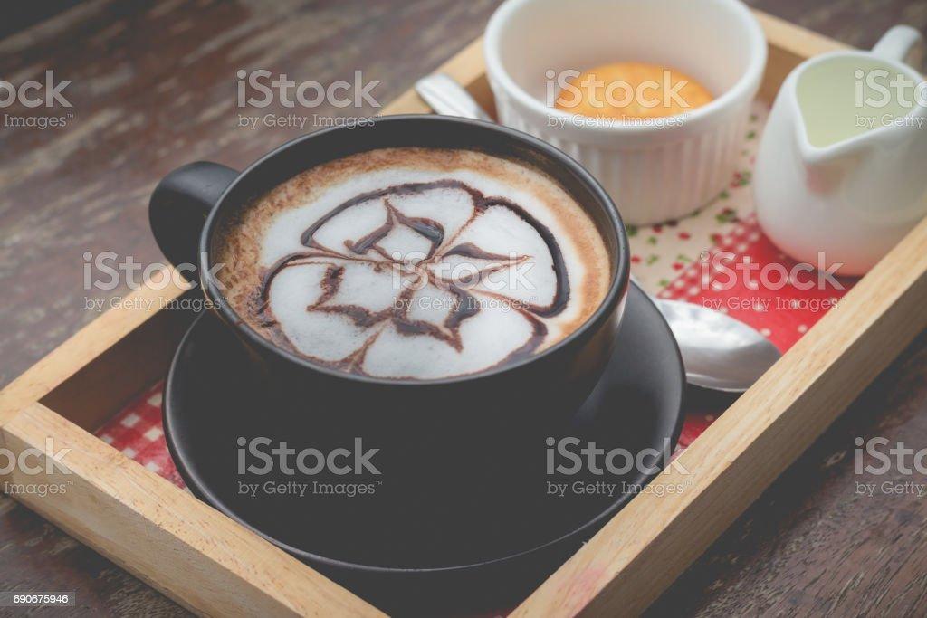 hot coffee with foam milk art. Black cup of coffee in afternoon break stock photo
