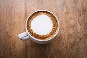 hot coffee with foam milk art
