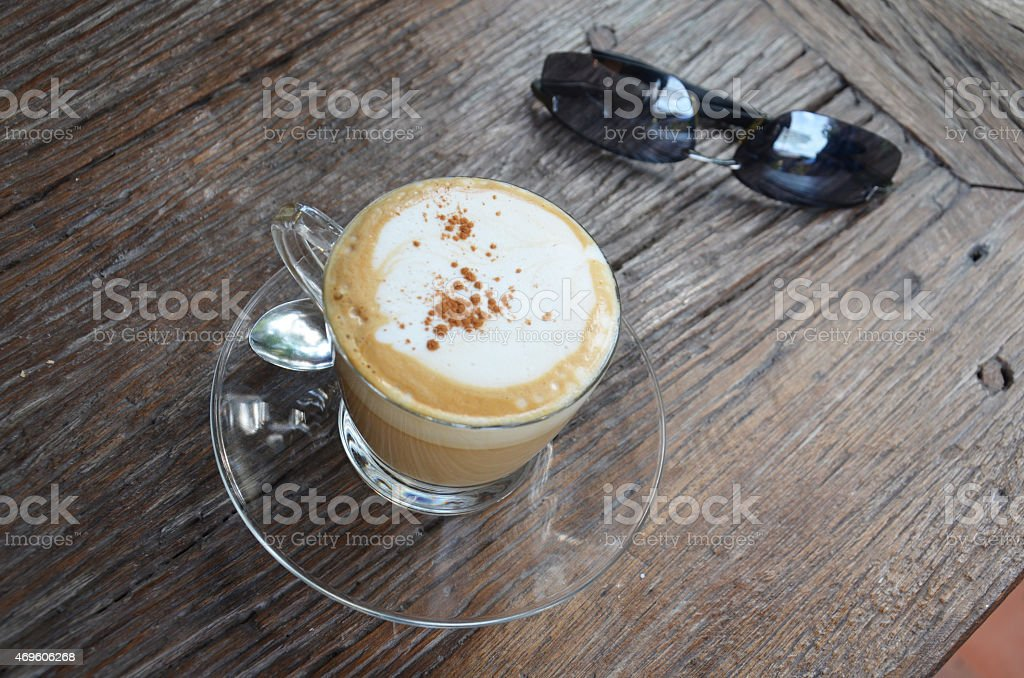 Hot Coffee with Sunglasses on Table stock photo