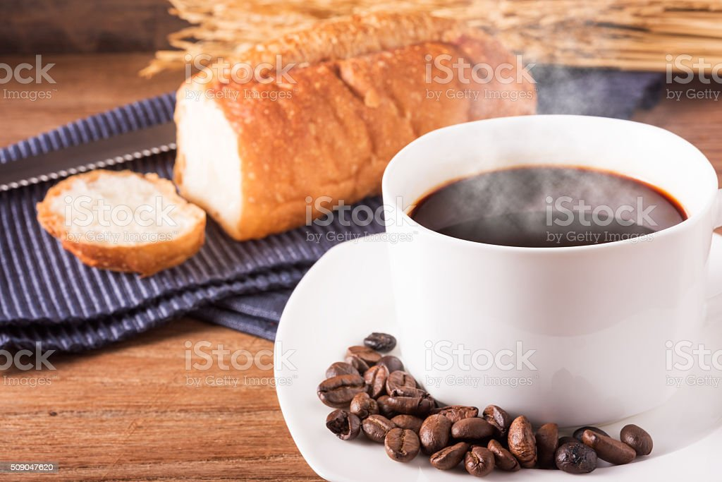 Hot coffee with the coffee beans and bread stock photo