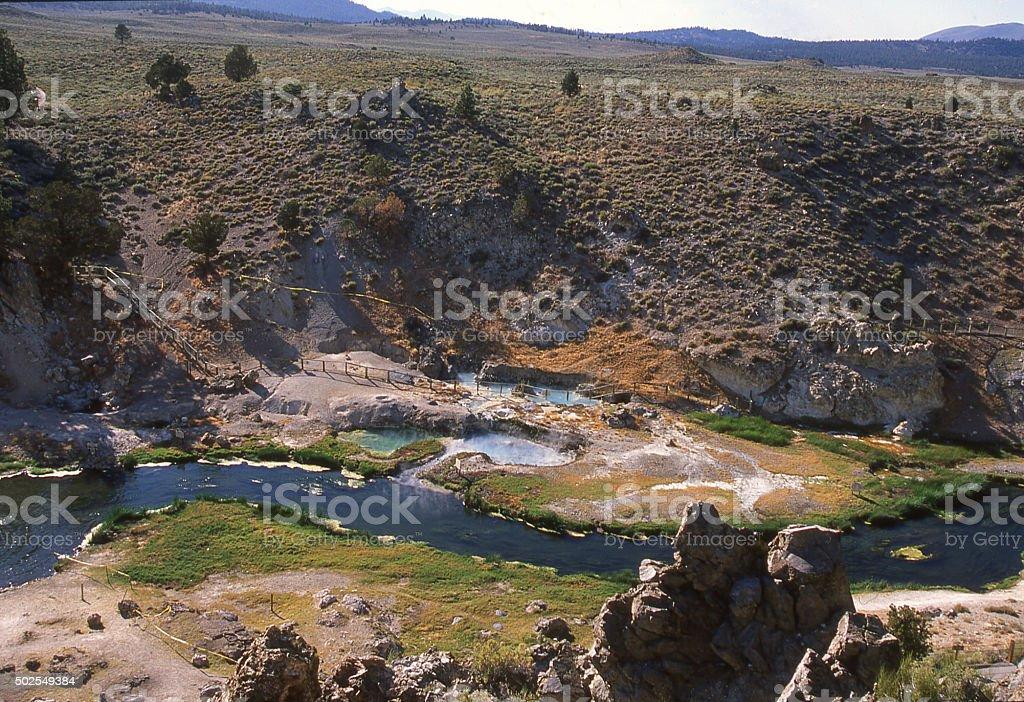Hot Creek geothermal pools sagebrush landscape near Mammoth Lakes California stock photo