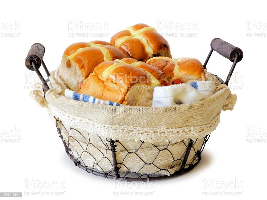 Hot Cross Buns in a vintage wire basket over white stock photo