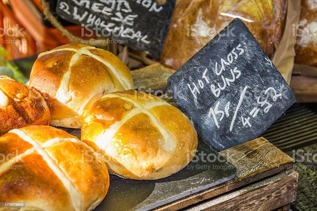 Hot cross buns on a farmers' market stall stock photo