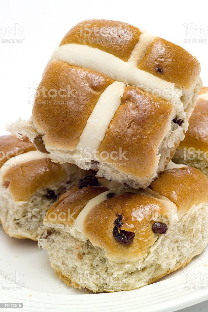 Hot Cross Buns on a white plate royalty-free stock photo